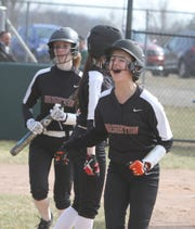 Kayla Errer (right) is one of nine returning softball players for Brighton.