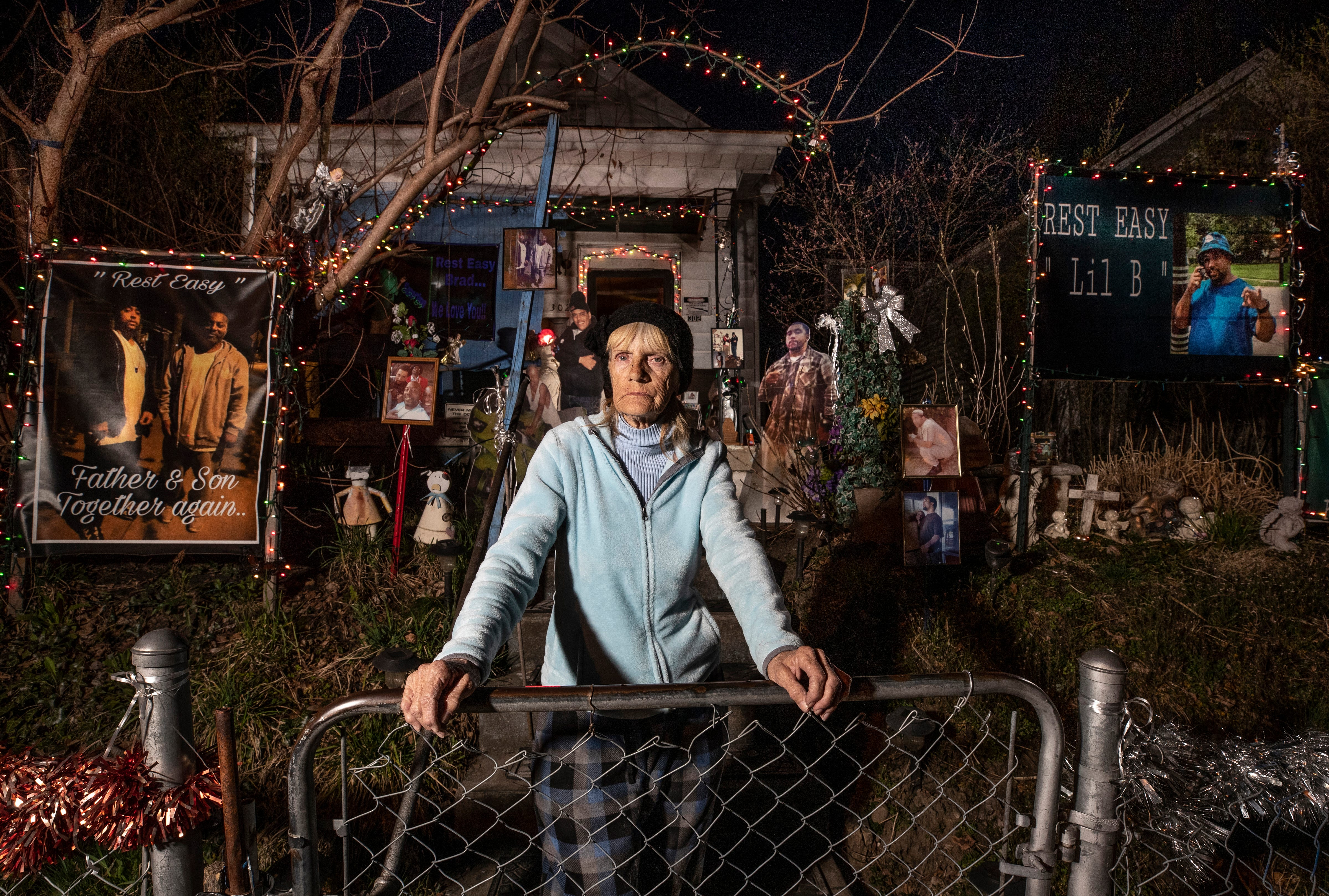 """Georgia """"Miss Dixie"""" Corcoran stands in her yard that she's turned into a shrine to the five men in her family who have died as a result of gun violence. March 28, 2019."""