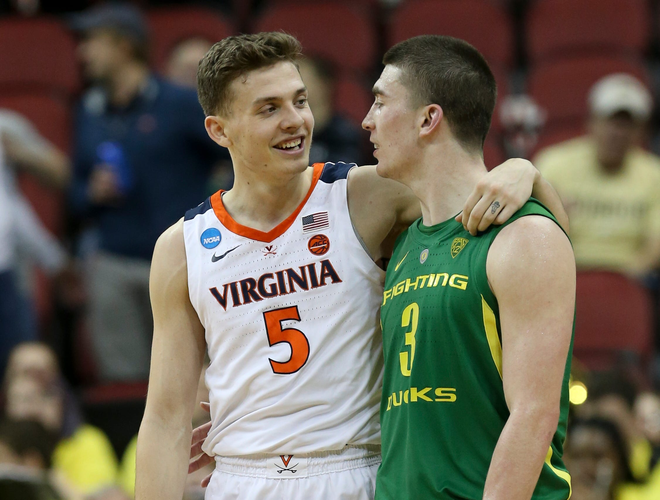 Virginia's Kyle Guy talks to Oregon's Payton Pritchard near the end of the game on March 29 in the NCAA Sweet 16.