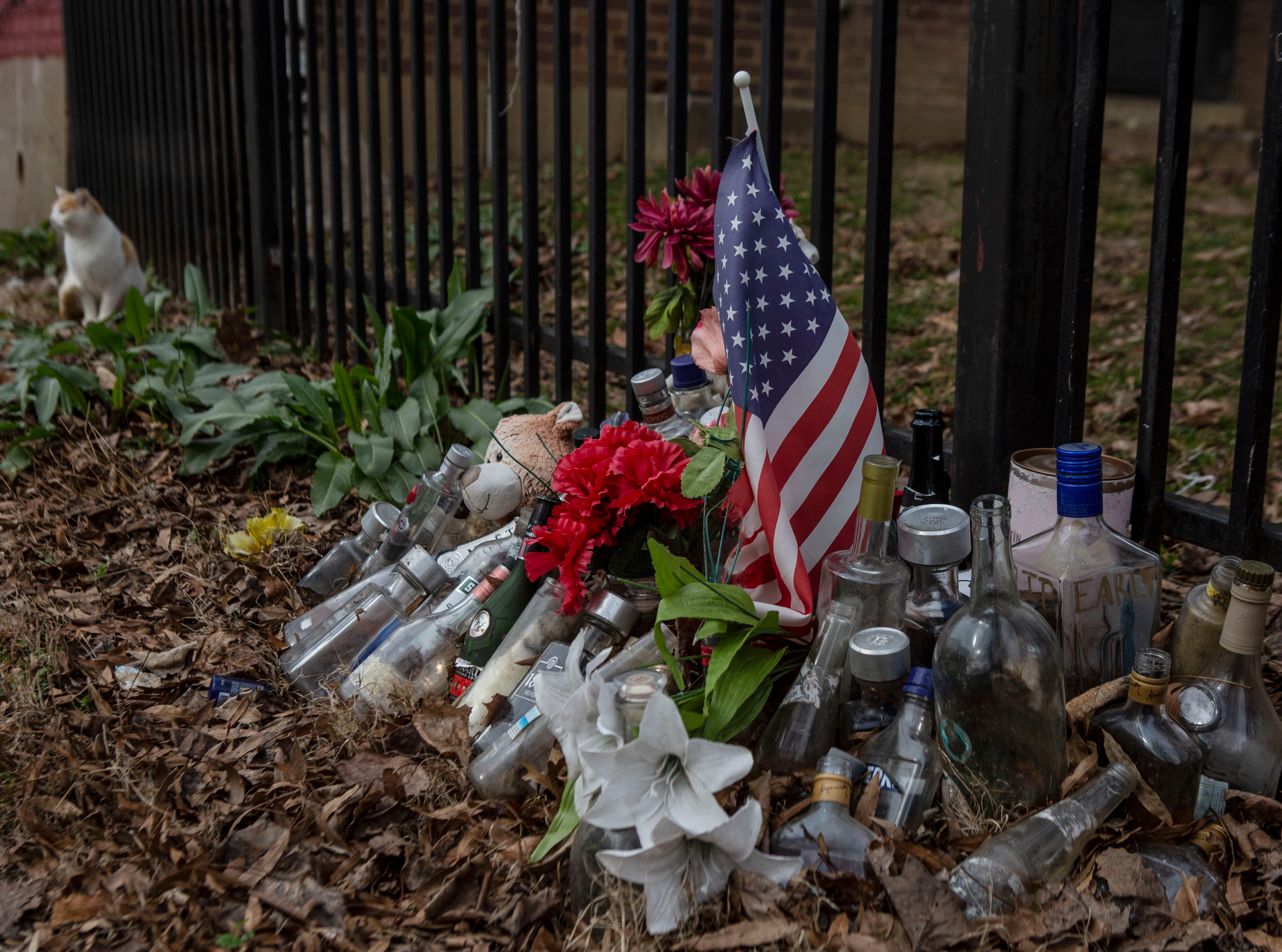 A shrine for Wilson Burton, 27, who was shot to death in the Beecher Terrace housing project in December 2016. Burton was found lying on the sidewalk in the afternoon.  Jan. 11, 2019