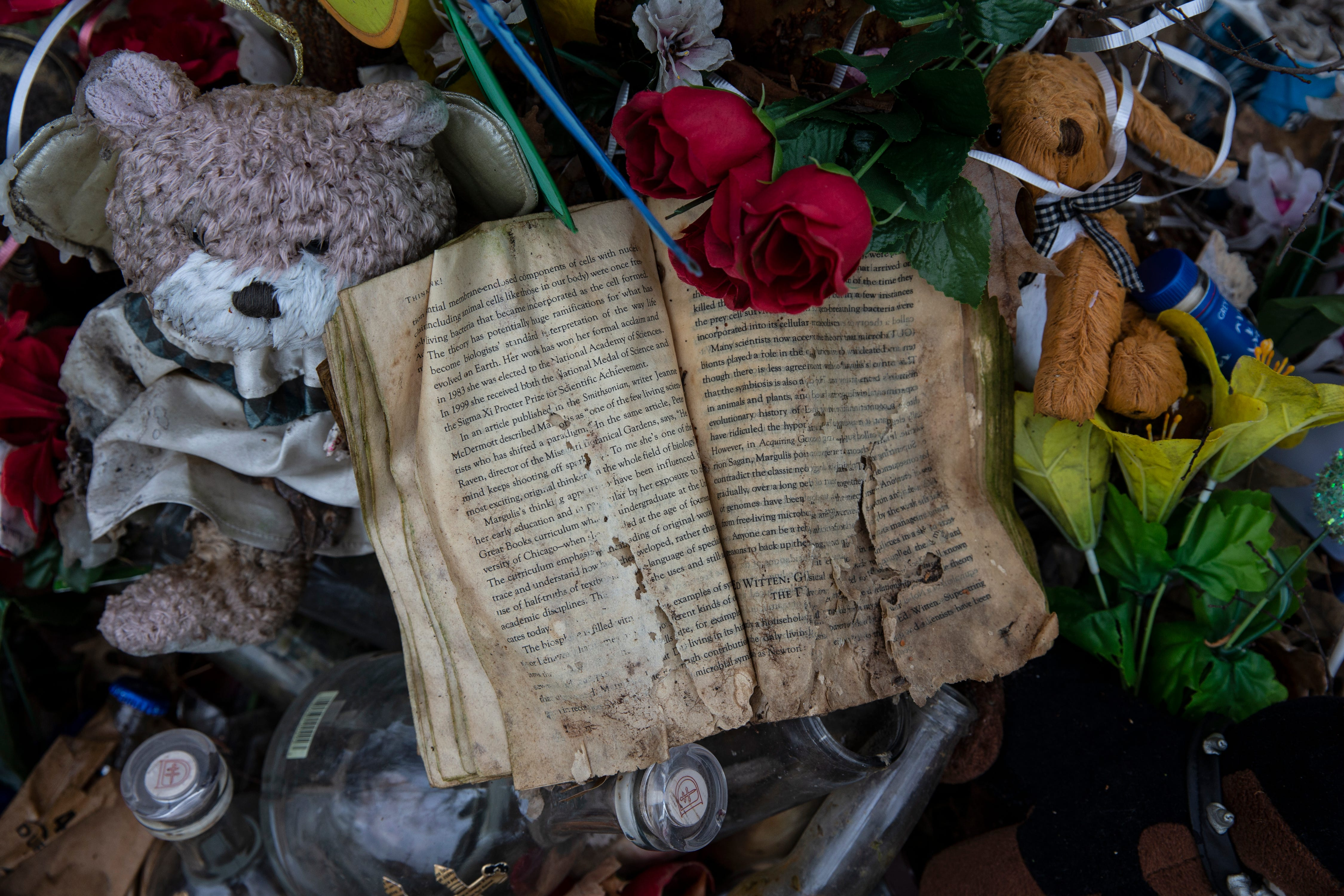 """The book, """"Th!nk, Why Crucial Decisions Can't Be Made in the blink of an Eye,"""" lies open at a makeshift memorial to Deshawn Brown, 30, who died after being shot near 41st and Broadway. March 21, 2019"""