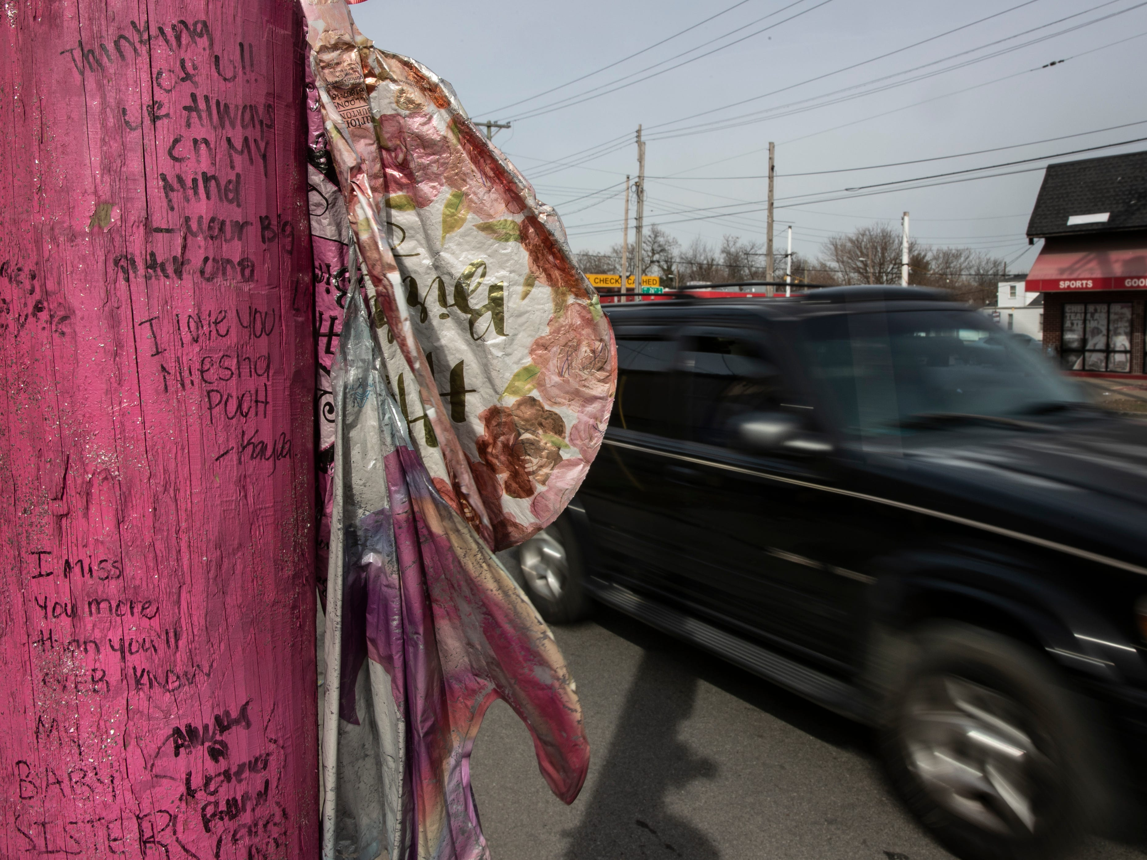 A utility pole was painted pink and adorned with flowers and messages of love on this makeshift shrine for Deniesha Pugh, 19, a hit-and-run homicide victim at 26th and Broadway, in 2015. March 12, 2019