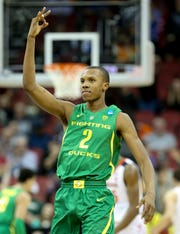 Oregon's Louis King celebrates after knocking down a three against Virginia on March 29 in the NCAA Sweet 16.