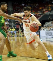 Virginia's Ty Jerome drives the ball against Oregon's Francis Okoro on March 29 in the NCAA Sweet 16.