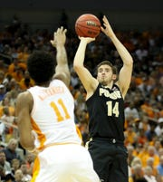Purdue's Ryan Cline knocks down a three over Tennessee's Kyle Alexander on March 28 in the NCAA Sweet 16.