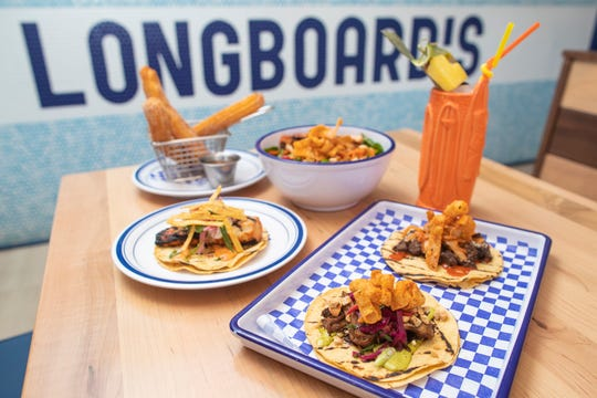 A full spread of dishes at Longboard's Taco and Tiki in New Albany, Indiana. March 27, 2019