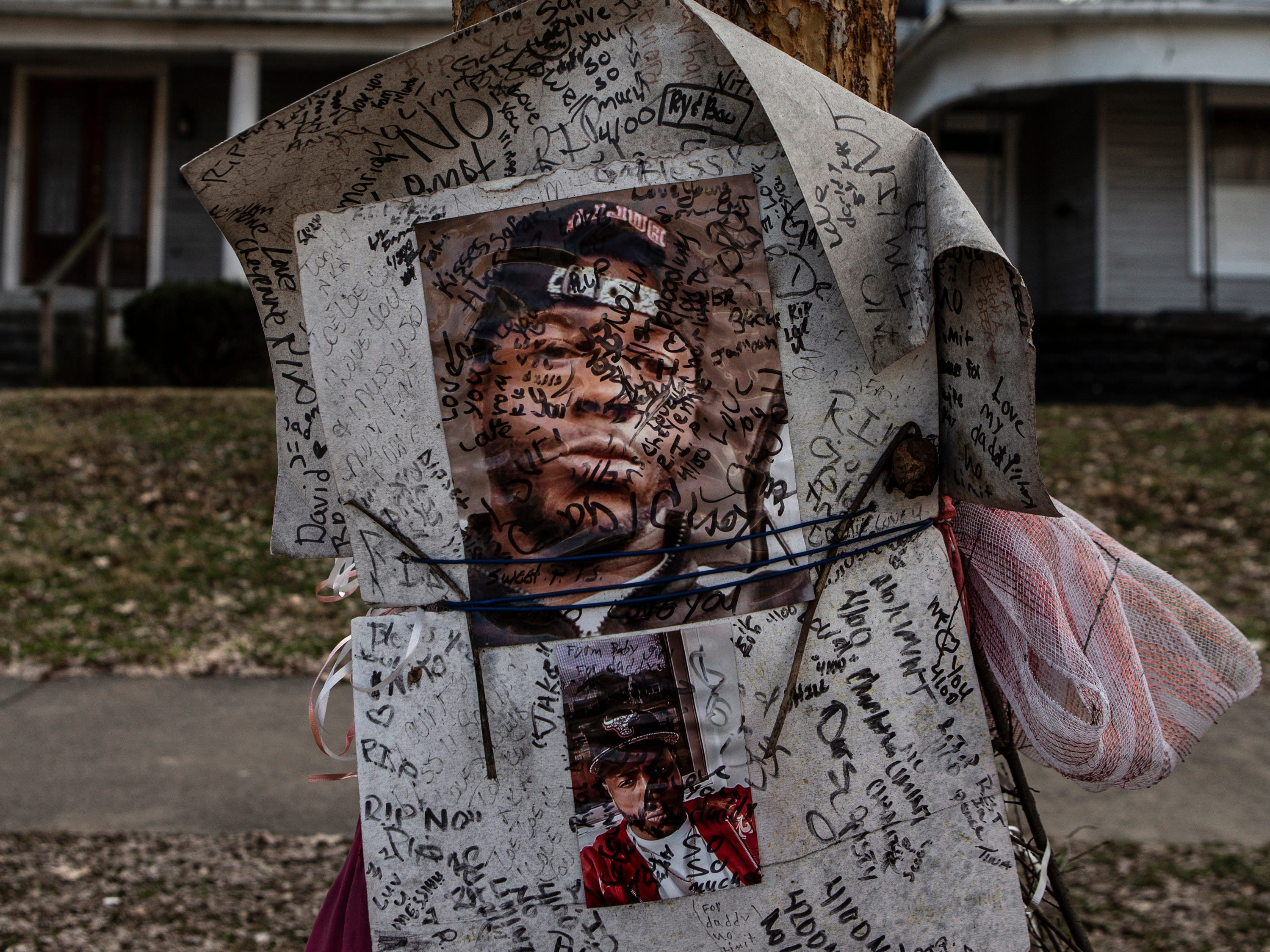 The face of Deshwan Brown, 30, can be seen through words of love on a shrine to him at 41st and Broadway, in Louisville. Brown was shot and killed a the site in 2018. Jan. 11, 2018.