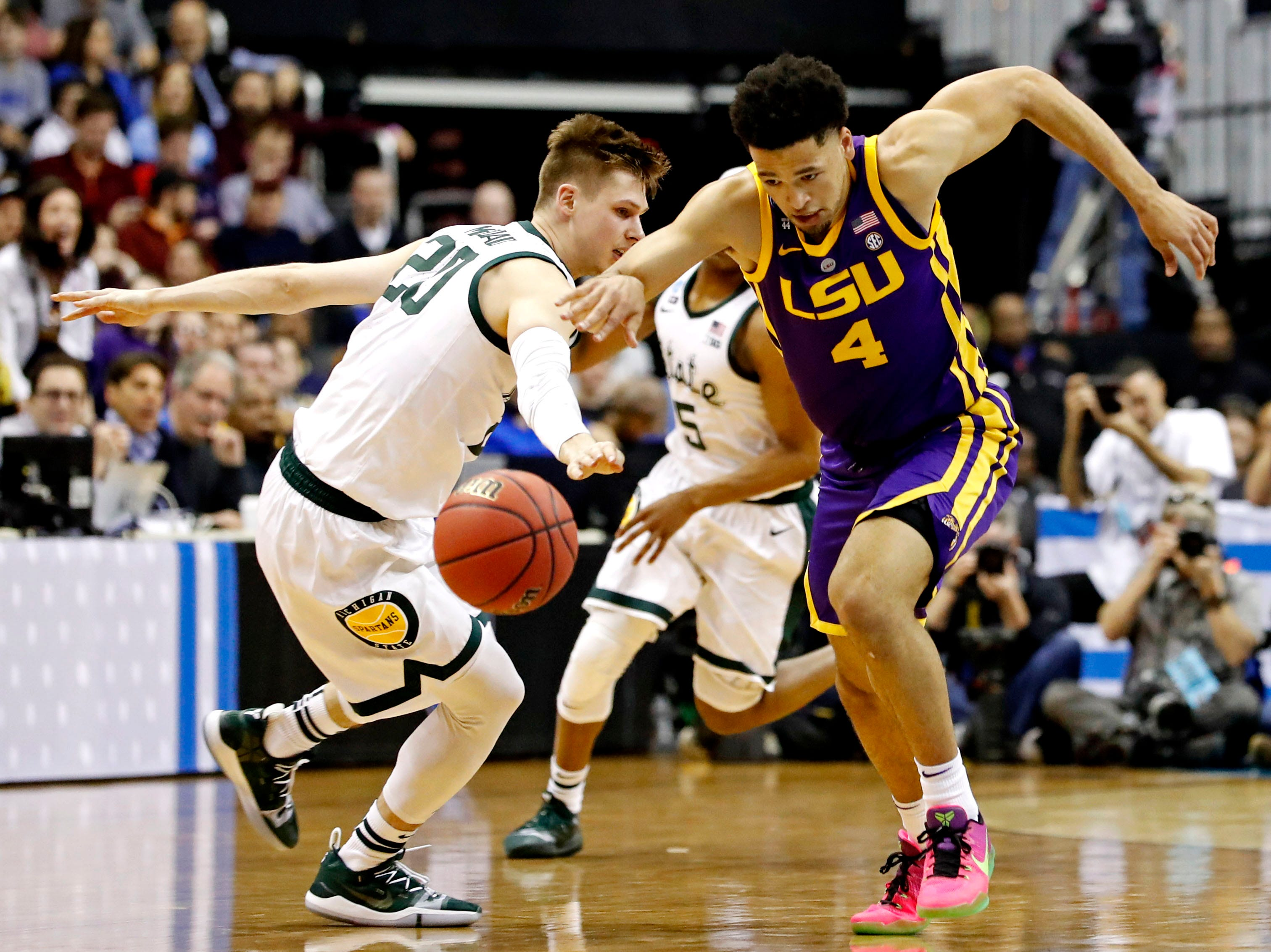 Mar 29, 2019; Washington, DC, USA; LSU Tigers guard Skylar Mays (4) brings the ball up court against Michigan State Spartans guard Matt McQuaid (20) during the first half in the semifinals of the east regional of the 2019 NCAA Tournament at Capital One Arena. Mandatory Credit: Geoff Burke-USA TODAY Sports