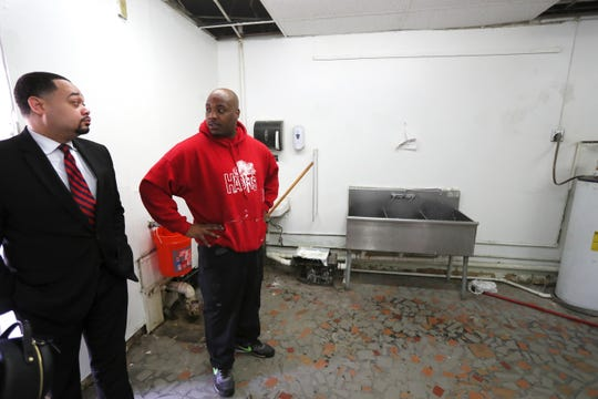 Trey McKnight, executive director of the Greater Whitehaven Economic Redevelopment Corporation, left, chats with Jason Gardner, who is working on his farm-to-table style restaurant Trap Fusion, set to open in mid-April, what McKnight notes is an example of positive development in the area, on Friday, March 29, 2019.
