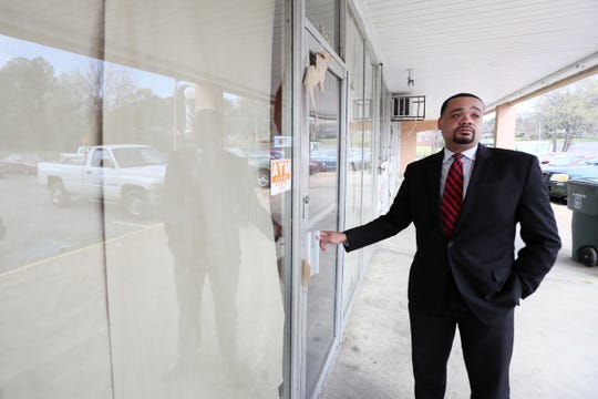 Trey McKnight, executive director of the Greater Whitehaven Economic Redevelopment Corporation, checks in on a friend's restaurant which is preparing to open in mid-April, what he says is an example of positive development in the area, on Friday, March 29, 2019.