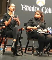 """Veronica Chambers, a New York Times editor and editor of """"Queen Bey,"""" a book of essays on Beyonce's power, listens as Talibah Safiya, a Memphis musician and jewelry artist, talks about Beyonce's influence on her millennial generation during a panel at Rhodes College."""