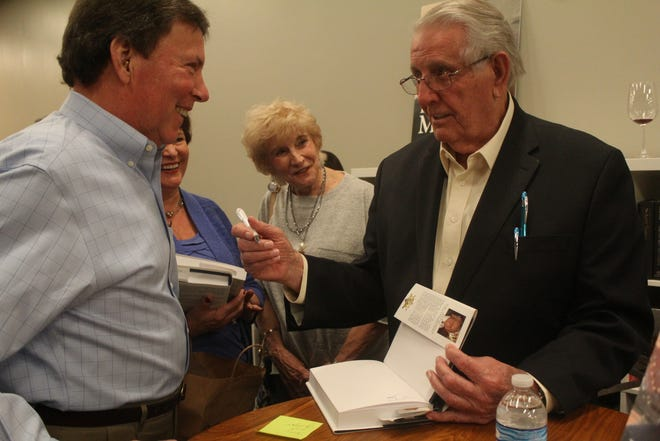 """Bill Morris (right), former mayor of Shelby County,  held a signing event on Thursday, March 28, 2019 for his book """"Bill Morris: A Legendary Life""""."""