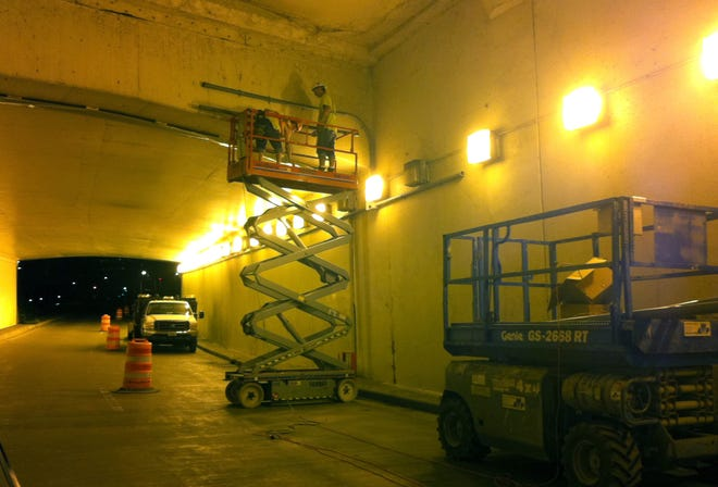 Workers perform maintenance on the Kilbourn Avenue tunnel I-43 entrance ramp in 2011.