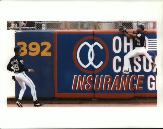 Chuck Carr (right) flies to the wall for a catch in 1997.