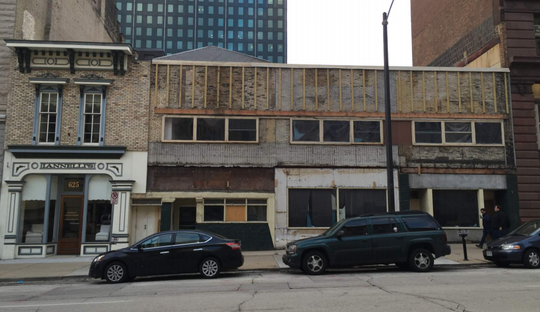 David Uihlein's three buildings on North Broadway before new facades were built had a dilapidated appearance.