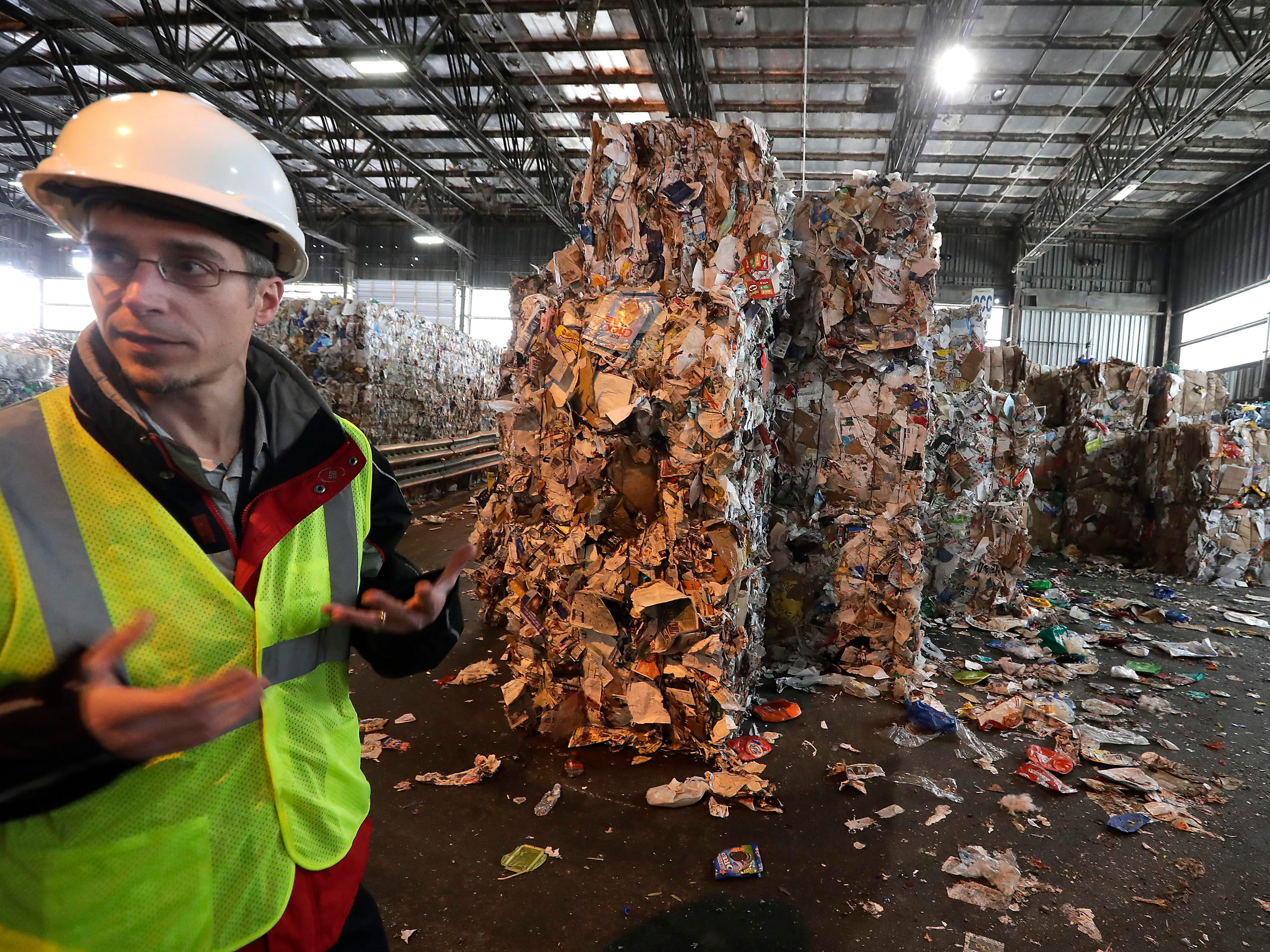 Rick Meyers, sanitation services manager at the Menomonee Valley recycling center jointly owned by the City of Milwaukee and 27 communities in Waukesha County, explains that recyclers  are facing rising costs and demands for a cleaner waste stream after China announced in January 2018 that it was effectively banning recycled waste from countries, including the U.S. because material was too dirty.