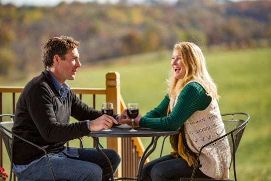 A couple drinks wine at Vernon Vineyards outside Viroqua.
