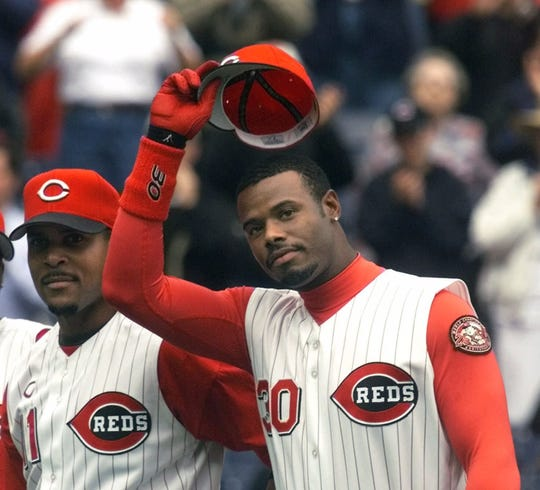 Ken Griffey Jr. tips his hat to the crowd in Cincinnati as he is introduced before the Red's opener against the Milwaukee Brewers on Monday, April 3, 2000.