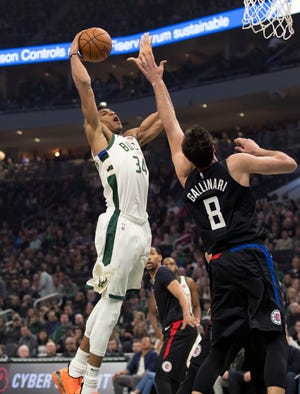 Mar 28, 2019; Milwaukee, WI, USA; Milwaukee Bucks forward Giannis Antetokounmpo (34) drives for a dunk during the first quarter against the LA Clippers at Fiserv Forum. Mandatory Credit: Jeff Hanisch-USA TODAY Sports