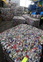 Bundled aluminum and steel cans are prepared for shipment to be recycled.