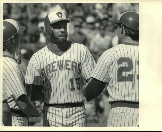 Cecil Cooper (15) was greeted by teammates in the eighth inning of a game in 1983.