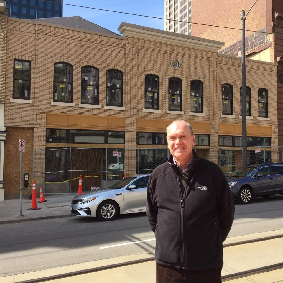 David Uihlein bought 7 downtown buildings in 2013. His focus is restoration and protection, not finding tenants.