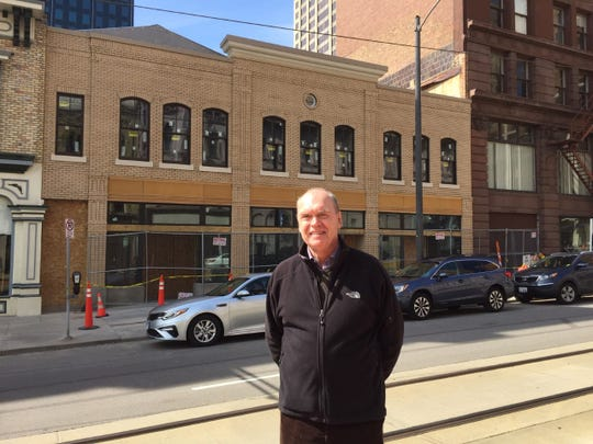 Retired architect David Uihlein is finishing the restored facades on three 19th century buildings on North Broadway, south of East Wisconsin Avenue.