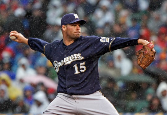 Milwaukee Brewer pitcher Ben Sheets throws against the Chicago Cubs at Wrigley Field as rain threatens Opening Day against the Chicago Cubs Monday, March 31, 2008.