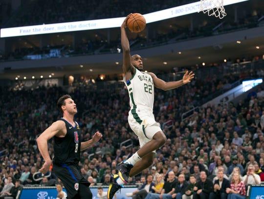 Bucks forward Khris Middleton drives for an easy basket Thursday night.