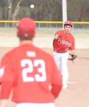 Flippin second baseman Preston Belding throws to first against Yellville-Summit on Thursday.