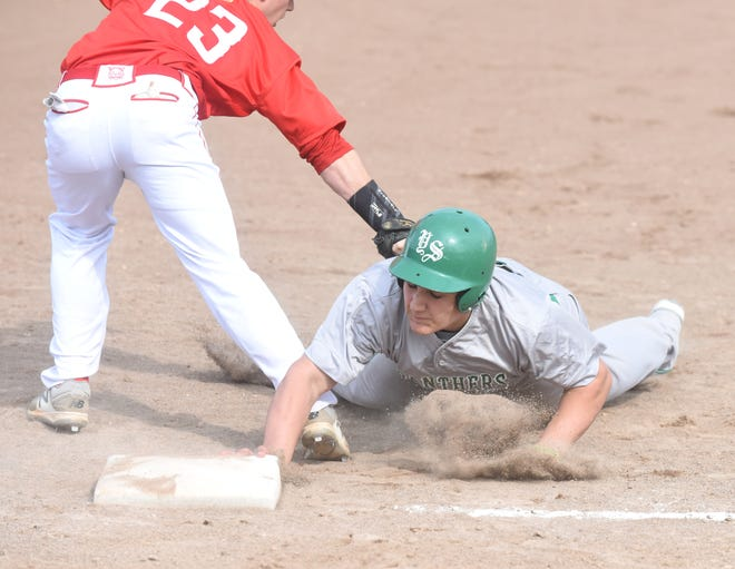 Yellville-Summit's Jadan Bardin tries to avoid the tag of first baseman Layton Fischer during the Panthers' 8-7 victory on Thursday.
