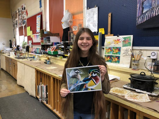 MHHS senior Breanna Hickmott shows off a photo of the wood duck painting that won the Arkansas Junior Duck Stamp Conservation contest. Hickmott's painting will be featured in the Federal Junior Duck Stamp contest in Laurel, Md., on April 19.