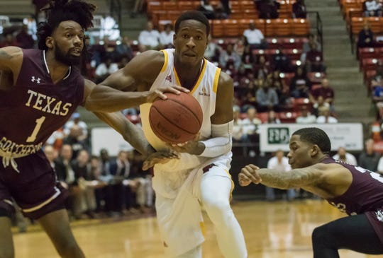 University of Louisiana at Monroe's Travis Munnings (1) looks to make a pass while Texas Southern's Jeremy Combs (1) and Tyrik Armstong (20) try to steal the ball during the quarterfinal game of the College Insider Tournament at Fant-Ewing Coliseum in Monroe, La. on March 28.