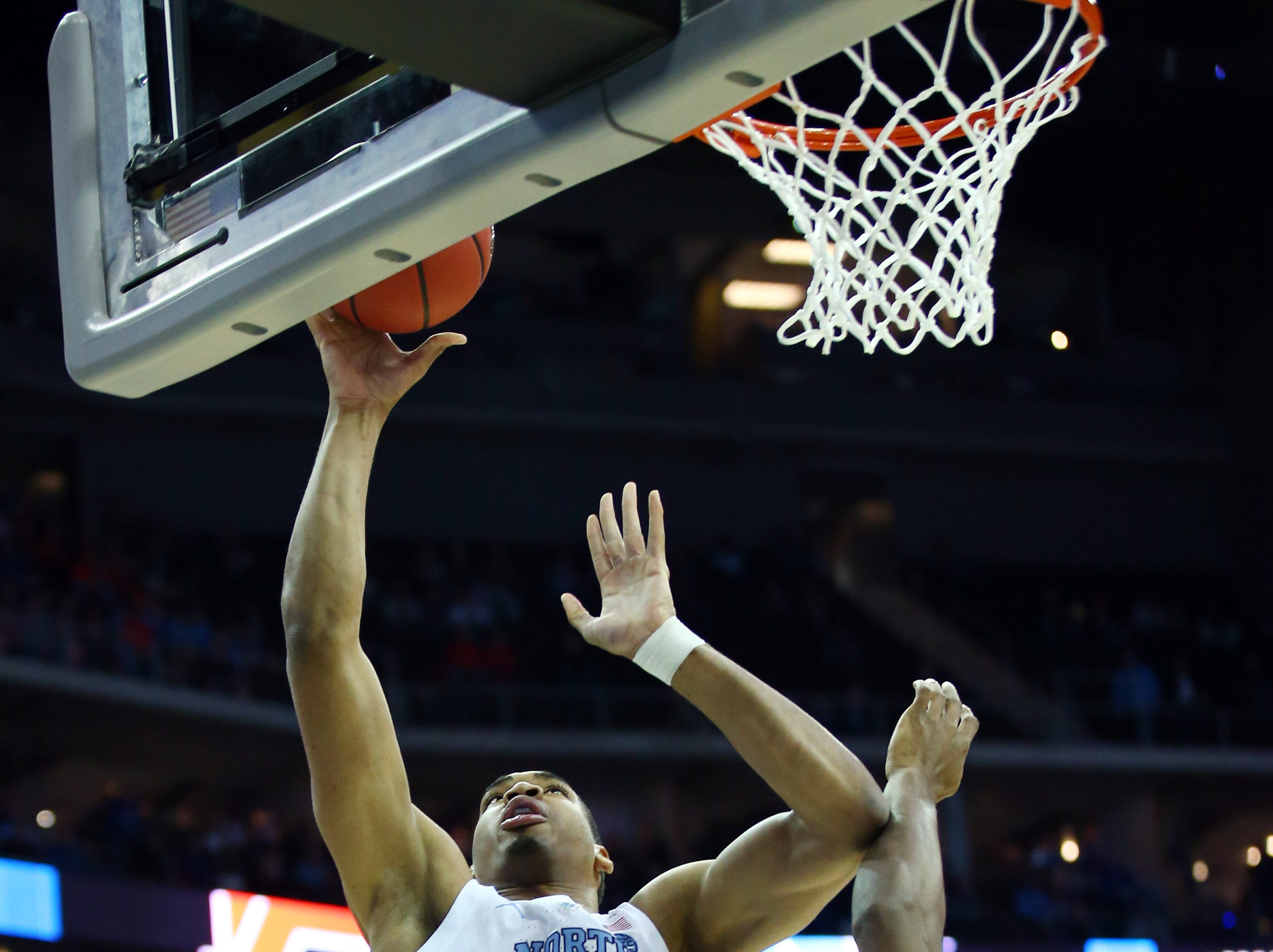 Mar 29, 2019; Kansas City, MO, United States; North Carolina Tar Heels forward Garrison Brooks (15) shoots over Auburn Tigers forward Anfernee McLemore (24) during the first half in the semifinals of the midwest regional of the 2019 NCAA Tournament at Sprint Center. Mandatory Credit: Jay Biggerstaff-USA TODAY Sports