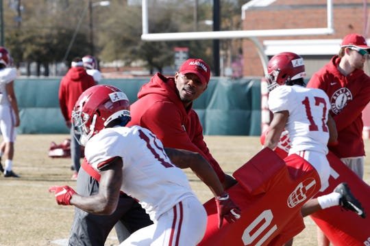 Alabama receivers coach Holmon Wiggins works with junior receiver Henry Ruggs III during a recent spring practice on March 22, 2019 in Tuscaloosa.