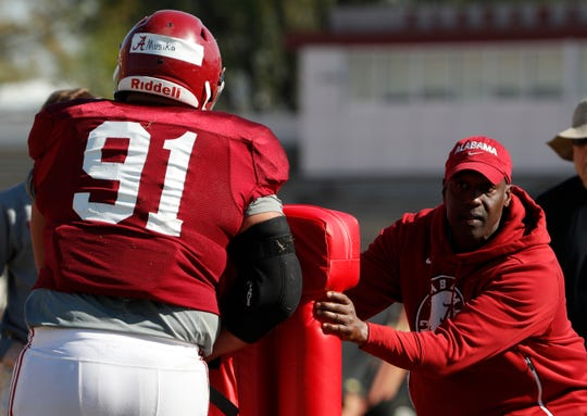 Alabama defensive line coach Brian Baker goes through a spring drill with senior defensive tackle Tevita Musika during a recent spring practice March 22, 2019 in Tuscaloosa. (Photo by Kent Gidley/Alabama athletics)