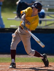 LAMP's Junhyung Park (11) swings at the ball at Montgomery Catholic High School in Montgomery, Ala., on Thursday, March 28, 2019. LAMP defeated Montgomery Catholic 11-1 in 7 innings.