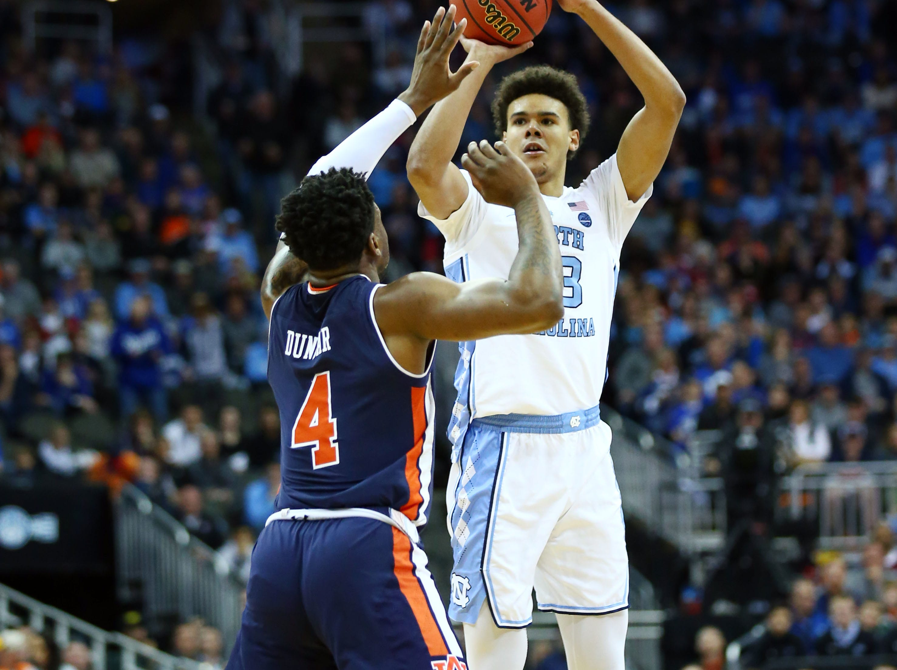 Mar 29, 2019; Kansas City, MO, United States; North Carolina Tar Heels guard Cameron Johnson (13) shoots against Auburn Tigers guard Malik Dunbar (4) during the first half in the semifinals of the midwest regional of the 2019 NCAA Tournament at Sprint Center. Mandatory Credit: Jay Biggerstaff-USA TODAY Sports