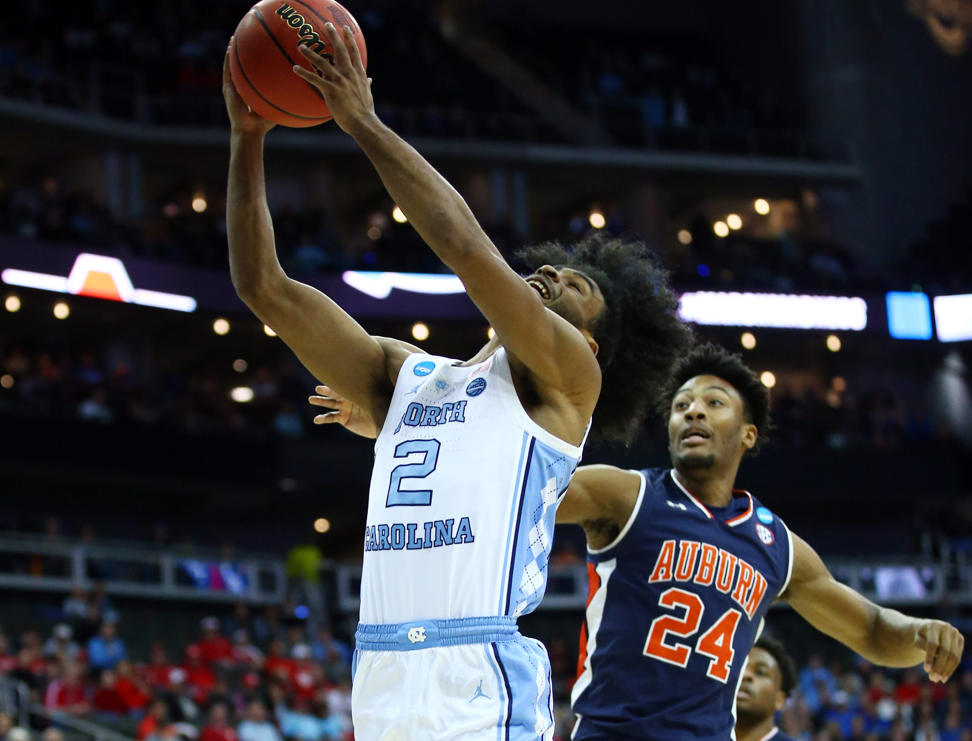 Mar 29, 2019; Kansas City, MO, United States; North Carolina Tar Heels guard Coby White (2) shoots against Auburn Tigers forward Anfernee McLemore (24) during the first half in the semifinals of the midwest regional of the 2019 NCAA Tournament at Sprint Center. Mandatory Credit: Jay Biggerstaff-USA TODAY Sports