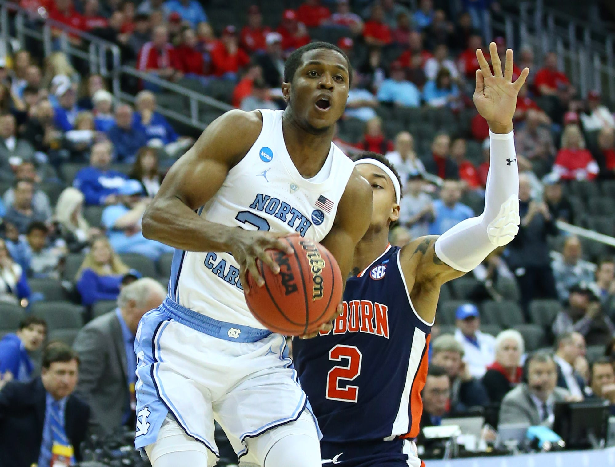 Mar 29, 2019; Kansas City, MO, United States; Auburn Tigers guard Bryce Brown (2) knocks the ball away from North Carolina Tar Heels guard Kenny Williams (24) during the first half in the semifinals of the midwest regional of the 2019 NCAA Tournament at Sprint Center. Mandatory Credit: Jay Biggerstaff-USA TODAY Sports