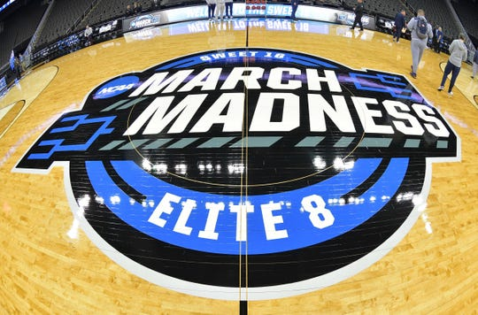 The March Madness logo at the center of the court at Sprint Center in Kansas City.