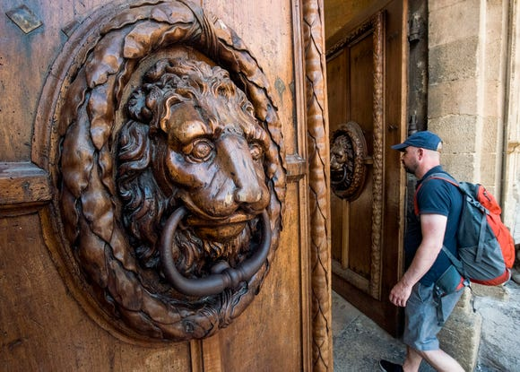 Giant door knockers on City Hall on Aix-en-Provence.