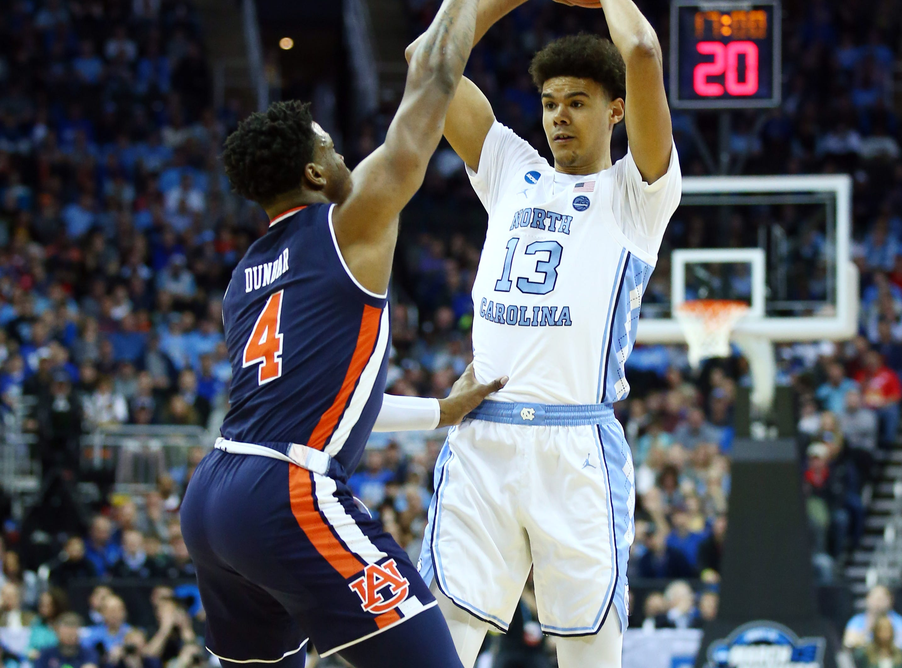 Mar 29, 2019; Kansas City, MO, United States; North Carolina Tar Heels guard Cameron Johnson (13) passes the ball against Auburn Tigers guard Malik Dunbar (4) during the first half in the semifinals of the midwest regional of the 2019 NCAA Tournament at Sprint Center. Mandatory Credit: Jay Biggerstaff-USA TODAY Sports