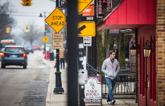 Pedestrian traffic moves along University Avenue in the Village Friday morning.