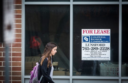 Signs advertising for lease properties are displayed throughout the Village on University Avenue Friday morning.