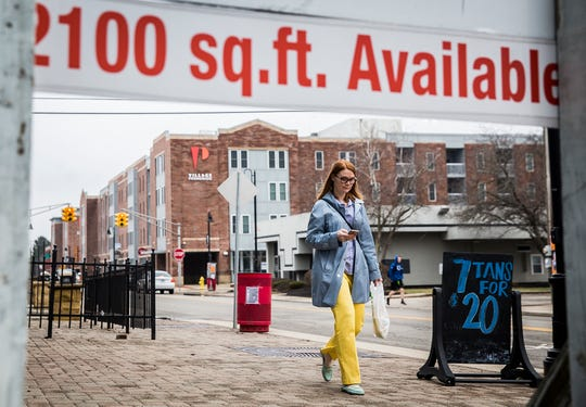 """A """"for lease"""" sign is positioned on University Avenue in the Village Tuesday morning."""