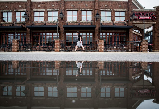 A pedestrian passes the former site of Scotty's on University Avenue in this file photo.
