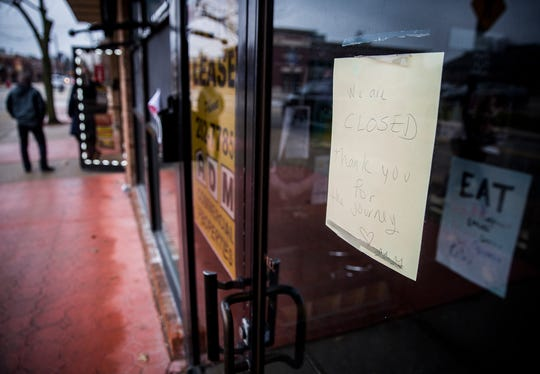 """A personalized """"closed"""" sign is taped to the door of the former Two Cats Cafe in the Village Friday morning."""