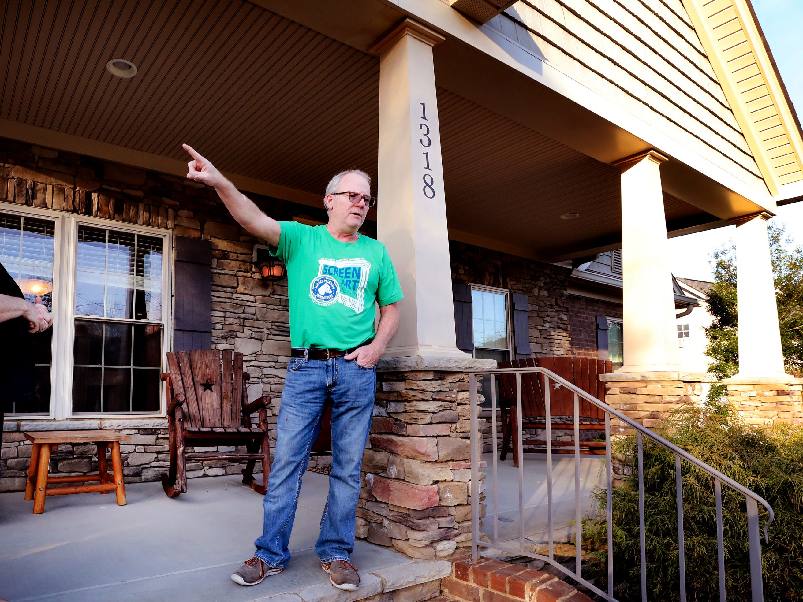 Mike Bickford stands on the porch of his Murfreesboro home, Wednesday March 27, 2019, and points to the direction that the Good Friday tornado came that destroyed his home ten years ago in 2009.