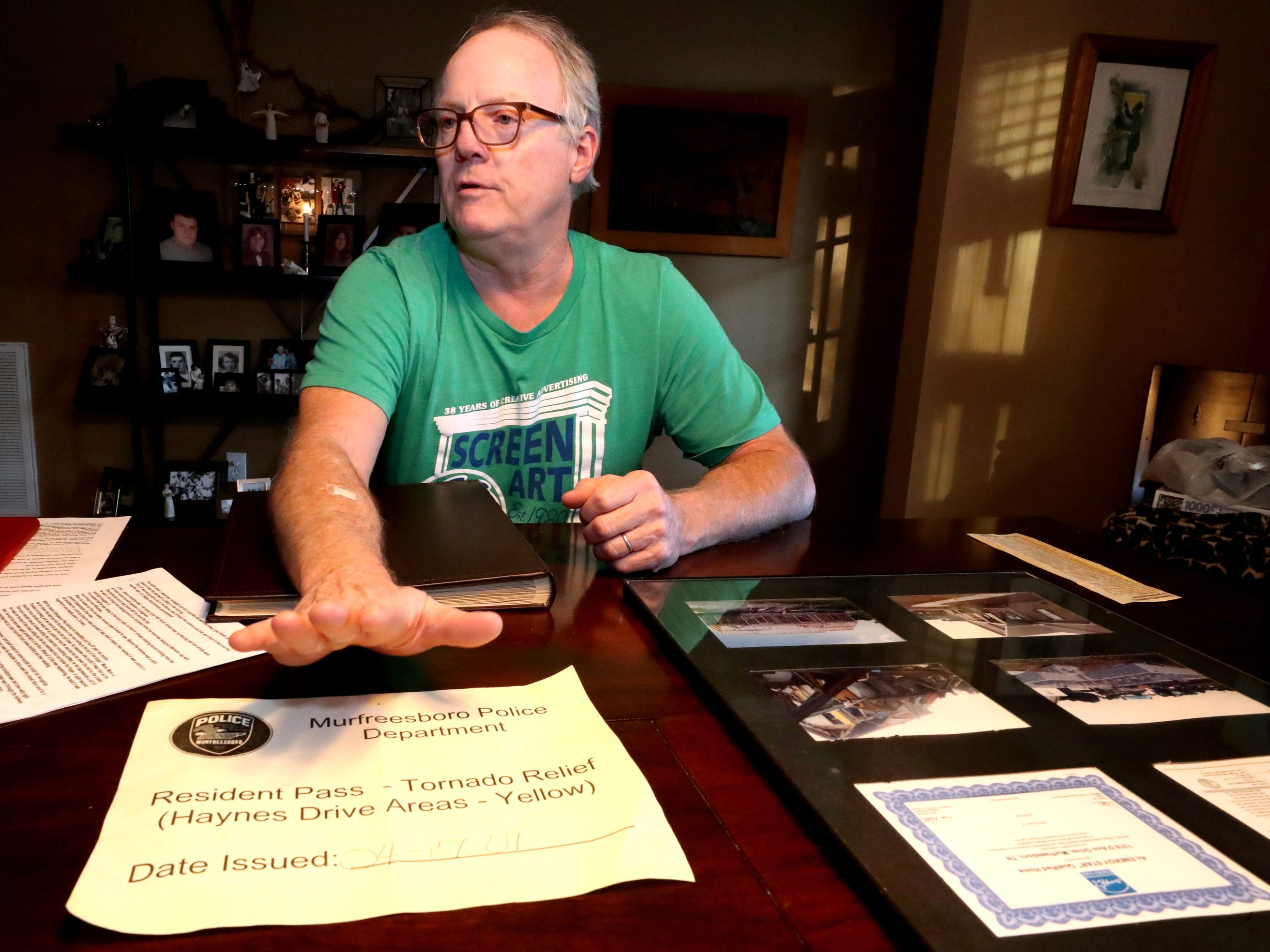 Mike Bickford shows off the sign that he put in his vehicle after the 2009 Good Friday tornado destroyed his home that allowed him to get in and out of his tornado damaged neighborhood, during an interview on Wednesday March 27, 2019.